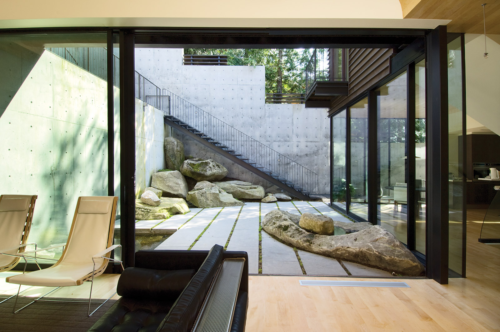 Showcase courtyard house on a steep site features What is an atrium in a house